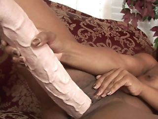 A Black Woman Shoves A Large Faux-cock In Her Smoothly-shaven Bald Snatch