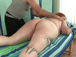 Redheaded Fat Female Scarlett Raven Has Her Fleshy Assets And Cunt Massaged